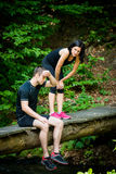 Couple relaxes after jogging Royalty Free Stock Image