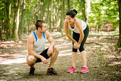 Couple relaxes after jogging Stock Photos