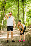 Couple relaxes after jogging Royalty Free Stock Images