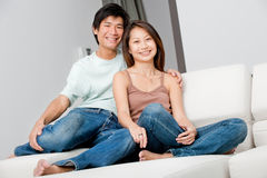 Couple Relaxing. A good looking couple relaxing on their couch at home royalty free stock photography