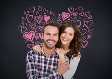 Couple relaxing against digitally generated background Royalty Free Stock Photo