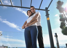 Couple relaxing on balcony Royalty Free Stock Images