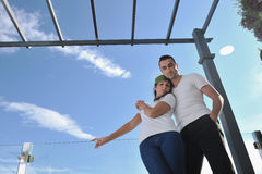 Couple relaxing on balcony Stock Photography