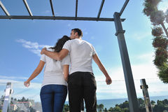 Couple relaxing on balcony Stock Images