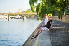 Couple relaxing on the bank of the Seine Royalty Free Stock Photography