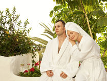 Couple relaxing after bath. Young couple relaxing after bath stock photos