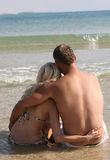 Couple relaxing on the beach Royalty Free Stock Photography