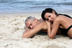 Couple relaxing on the beach Stock Photography