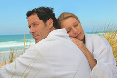 Couple relaxing at the beach Royalty Free Stock Photo