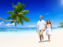 Couple Relaxing on the Beach Royalty Free Stock Images