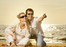 Couple relaxing on the beach Stock Images