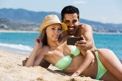 Couple relaxing on beach royalty free stock photo