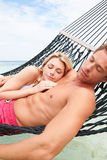 Couple Relaxing In Beach Hammock Royalty Free Stock Photography