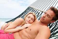 Couple Relaxing In Beach Hammock Royalty Free Stock Photos