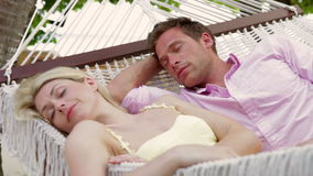 Couple Relaxing In Beach Hammock stock video