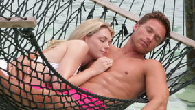 Couple Relaxing In Beach Hammock stock video footage