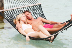 Couple Relaxing In Beach Hammock Stock Photography