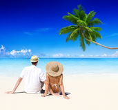 Couple Relaxing on the Beach Honeymoon Vacation Concept Stock Photos