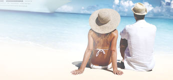 Couple Relaxing on the Beach Romantic Concept Stock Photo