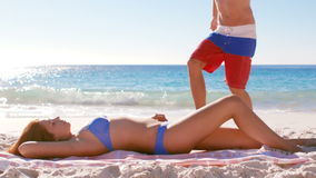 Couple relaxing at the beach. Slow motion of couple relaxing at the beach on a sunny day stock footage