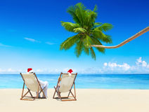 A Couple Relaxing on the Beach on a Sunny Day Royalty Free Stock Images