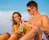 Couple relaxing on a beach Royalty Free Stock Image