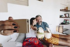 Couple relaxing on the bed stock photography