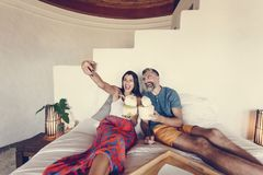 Couple relaxing on the bed royalty free stock photo