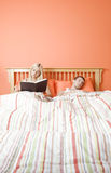 Couple Relaxing in Bed Royalty Free Stock Photos