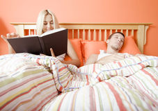 Couple Relaxing in Bed Stock Photo