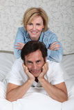 Couple relaxing on bed Royalty Free Stock Photography