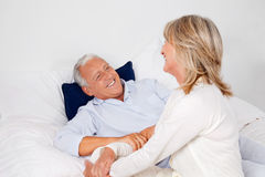 Couple Relaxing in Bed Stock Photography