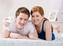 Couple relaxing in bed and hugging Stock Photography