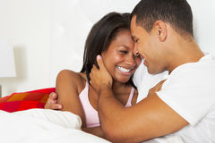 Couple Relaxing In Bed Wearing Pajamas Royalty Free Stock Photo