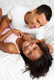 Couple Relaxing In Bed Wearing Pajamas Stock Images