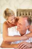 Couple Relaxing In Bedroom Royalty Free Stock Photography