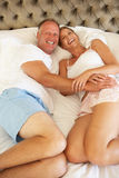 Couple Relaxing In Bedroom Stock Image