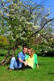 Couple relaxing in a blossoming spring garden royalty free stock image