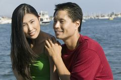Couple relaxing on boat Stock Photography