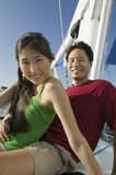 Couple relaxing on boat Stock Image