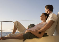 A couple relaxing on a boat royalty free stock photography
