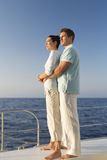 A couple relaxing on a boat Royalty Free Stock Photos