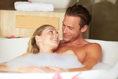 Couple Relaxing In Bubble Bath Together Stock Images
