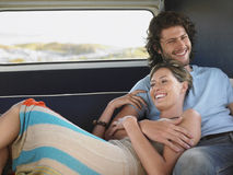 Couple Relaxing In Campervan During Road Trip Royalty Free Stock Photography