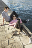 Couple Relaxing By Canal Royalty Free Stock Photography