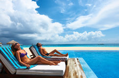 Couple relaxing at the poolside Royalty Free Stock Photo