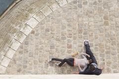 Couple Relaxing On Cobblestones Stock Images