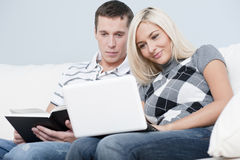 Couple Relaxing on Couch Stock Image