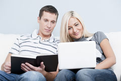 Couple Relaxing on Couch Royalty Free Stock Photography