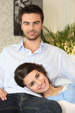Couple relaxing on the couch Stock Photos